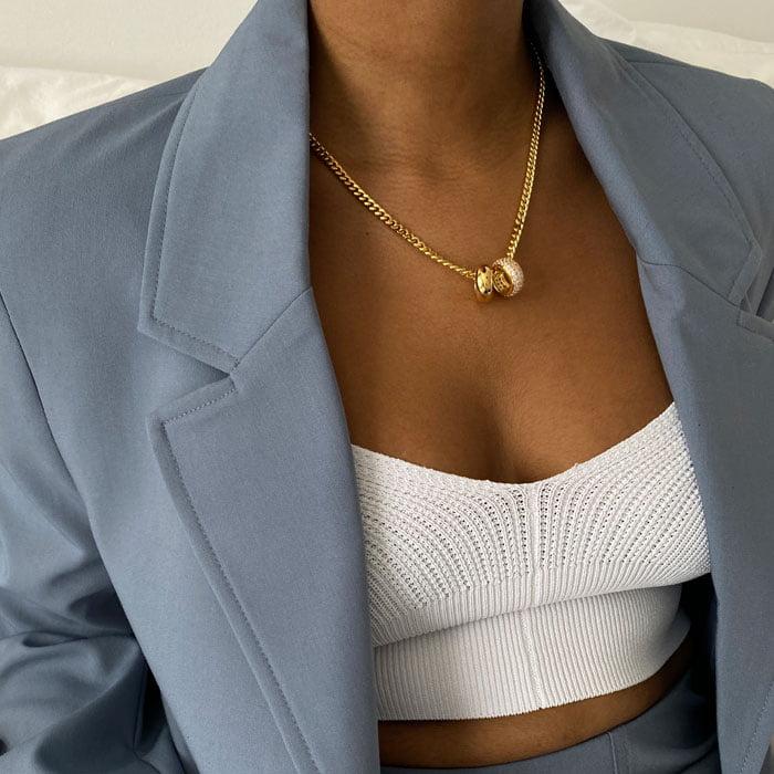 Zircon ring pendant and ring pendant