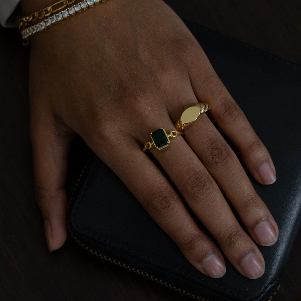 Signet wave ring and cubic emerald ring