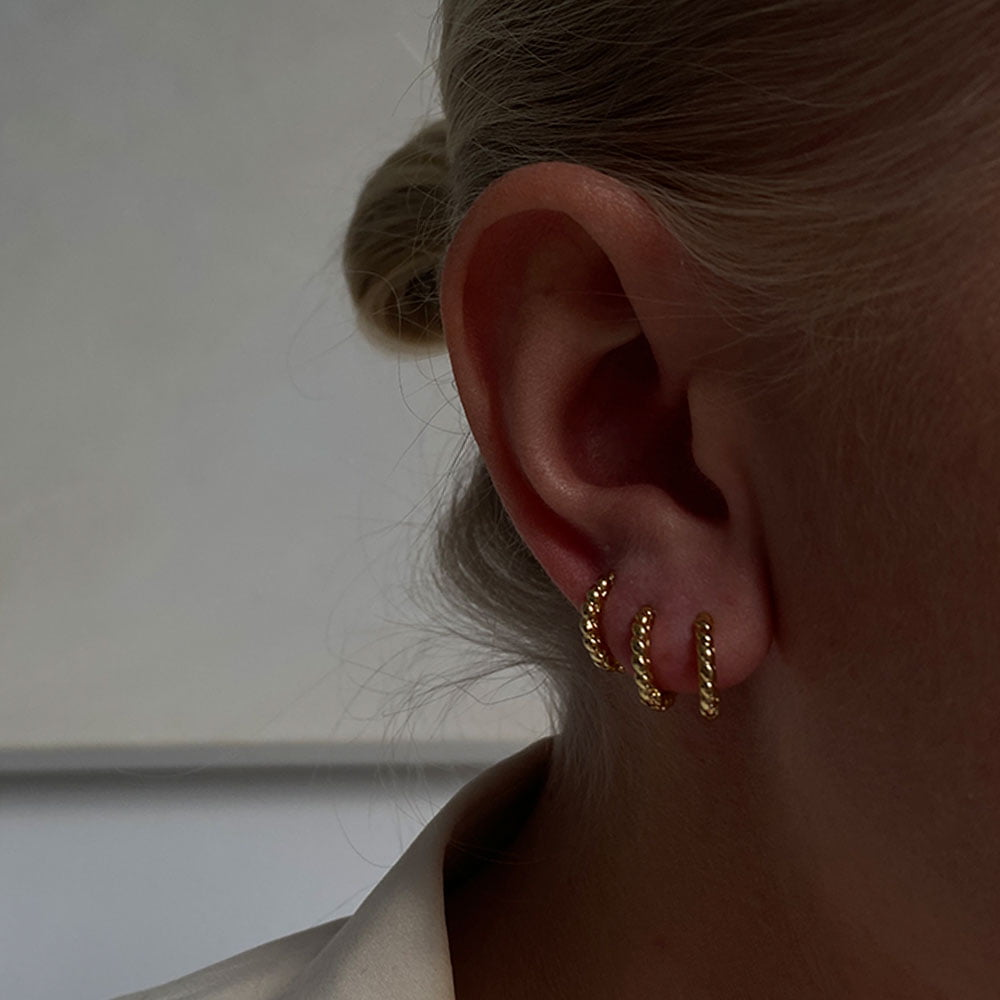 twisted mini huggie hoops made in 18k gold plated brass